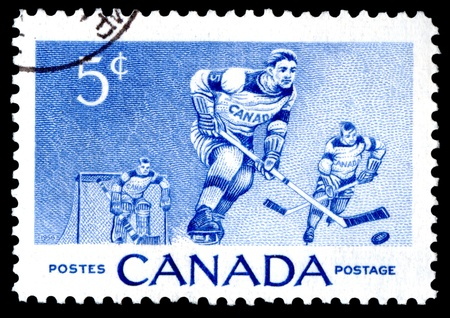 Canada postage stamp showing ice hockey players photo
