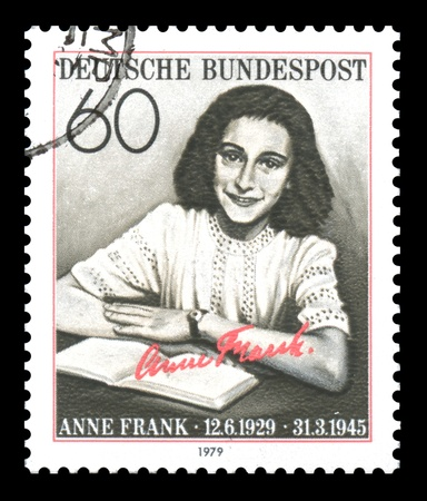 German postage stamp showing an image of Anne Frank, who as a young girl was a victim of the Holocaust, later to become famous for her diary published as The Diary of a Young Girl, after the Second World War Stock Photo