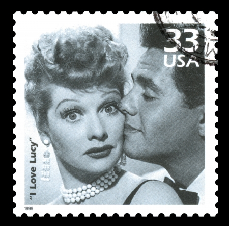 philately: London, UK – February 5, 2012: USA postage stamp showing a clip of Lucille Ball and Desi Arnez from the popular television sitcom
