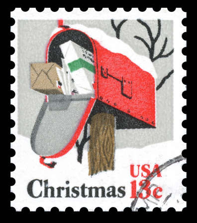 USA vintage postage stamp showing an image of a mailbox at Christmas stuffed full of packages and parcels
