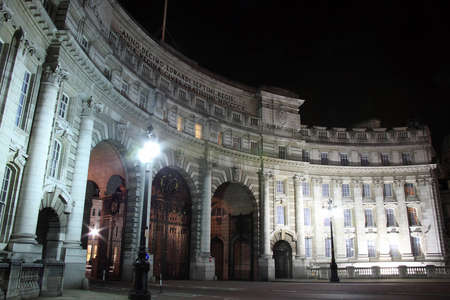 Admiralty Arch at night , which was completed in 1912 and commissioned by Edward V11 in memory of his mother Queen Victoria  It provides an archway and pedestrian access between The Mall and Trafalgar Square  photo
