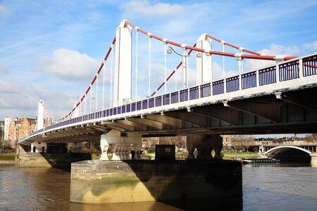 chelsea: Chelsea Bridge across the River Thames connecting Chelsea to Battersea, London , England, UK Stock Photo