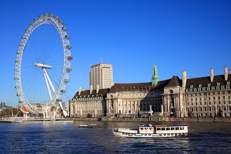 thames: London, UK – October 27, 2011: The London Eye and the Sea Life London Aquarium, which is housed in the former County Hall building on the South Bank of the River Thames, as seen from Westminster Bridge Editorial