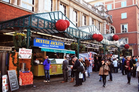 London, UK � November 13, 2011: Tourists and shoppers queuing for jacket potatoes at the Jubilee Market Hall in Covent Garden at Christmas