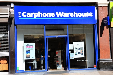 London, United Kingdom, Apr 1, 2012 : The Carphone Warehouse retail outlet in Oxford Street with an iphone 4s advert in it