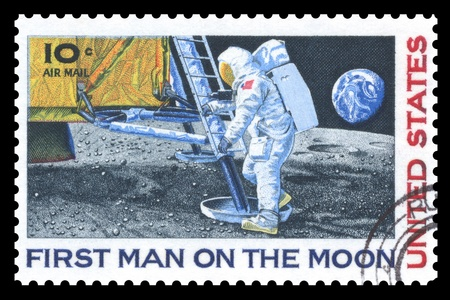 USA vintage postage stamp commemorating the first man on the moon
