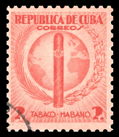 postage stamp: Vintage red Cuba postage stamp with an engraved image of an Havana tobacco cigar