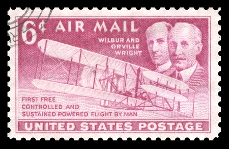 postage stamp: USA vintage airmail postage stamp showing an image of the Orville and Wilbur Wright, two  brothers who were early pioneers of aviation flight Stock Photo