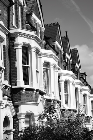 terraced: Black and white monochrome photograph of Victorian terraced town houses in London, England, UK
