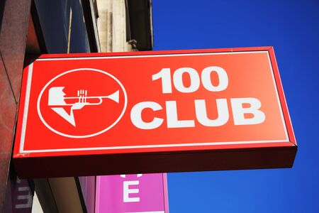 music venue: London, United Kingdom, April 1, 2012 : The 100 club logo advertising sign outside the famous cult music venue at 100 Oxford Street