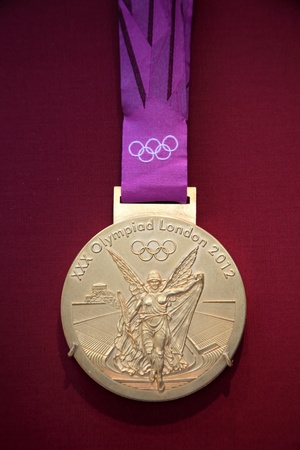 olympic sports: London, United Kingdom, April 10, 2012 : 2012 Olympic Games gold medal on display at the British Museum