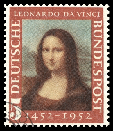 Germany postage stamp with a portrait image of the smiling Mona Lisa by the medieval Renaissance artist and inventor Leonardo Da Vinci