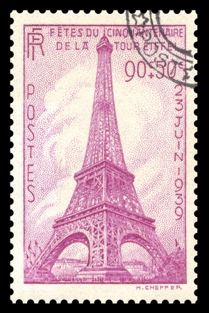 Vintage 1939, France postage stamp showing an engraved image of the Eiffel Tower in Paris, France Editorial