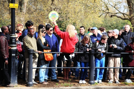 Tour: An Original Tour guide, giving information to large group of  sightseeing customers in Birdcage Walk