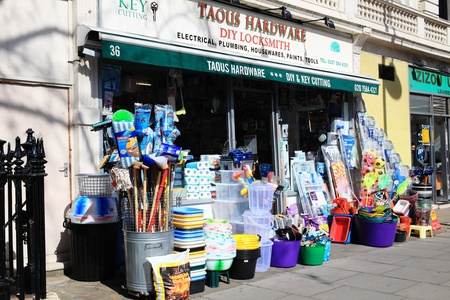 Hardware store Harrington Road, Kensington displaying its merchandise outside to attract customers