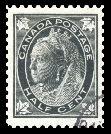 timbre postal: Antiguo finales del siglo 19 Canadá ciento mitad negro, sello, que muestra una imagen grabada de la reina Victoria Foto de archivo