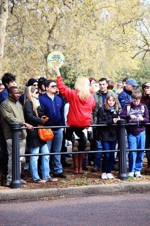 London, UK - April 14, 2012: An Original Tour guide, giving information to large group of  sightseeing customers in Birdcage Walk