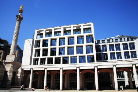 lunchtime: London, UK - May 27, 2012: A quiet lunchtime outside the London Stock Exchange in Paternoster Square Editorial