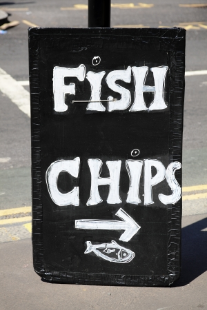 uk cuisine: UK fish and chips sign advertising the traditional English take away meal