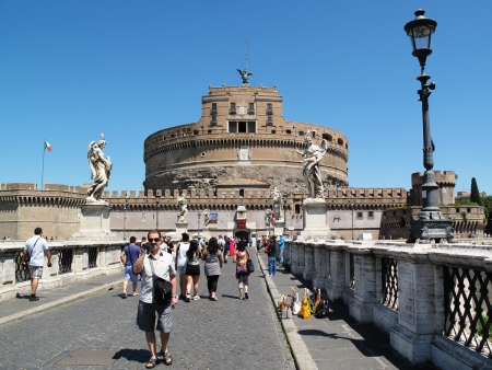 2nd century:   Rome, Italy - July 16, 2012:  Tourists crossing the bridge to Castel Sant Angelo, the mausoleum of the Roman Emperor Hadrian, on their way to see the museum inside