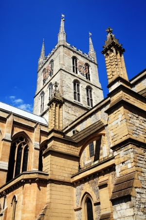 Southwark Cathedral stands at the south end of London Bridge, London, England, UK  It is believed to have been built around 666AD, largely rebuilt in a Norman Gothic style after a fire in 1206AD photo