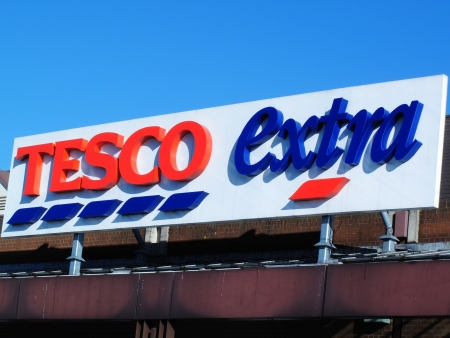 shopping centre: London, UK � February 2, 2012:  The entrance sign to the Tesco Extra supermarket store in the Surrey Quays Shopping Centre, Southwark