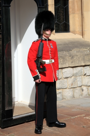 sentry: London, UK - September 9, 2012: Coldstream Guard standing at his sentry box on guard at the Tower of London