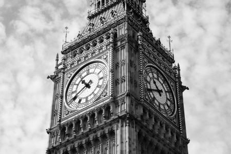 Black and white, monochrome image of the clock face of Big Ben of the Houses Of Parliament in Westminster, London, England, UK which was built on the site of the Royal Palace Of Westminster, in a Gothic style, after a fire in 1834