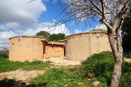 ancient civilisations: Reconstruction of houses of the Chalcolithic Period  Bronze Age  3500BC at Lempa Experimental Village, Cyprus Editorial