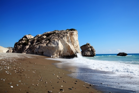 Rock of  Aphrodite  Petra Tou Romiou  the birthplace of Aphrodite the Greek goddess of love, on a shoreline beach of  Western Cyprus between Paphos and Limassol, facing the Mediterranean Sea with a clear blue sky