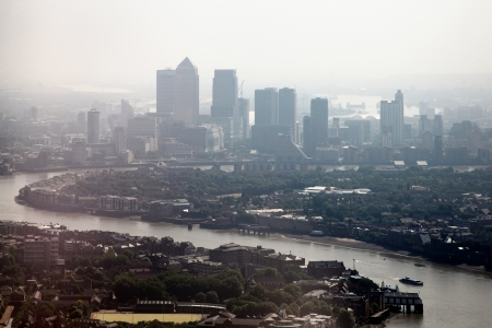 Aerial cityscape of the River Thames and the skyscrapers of Canary Wharf, London Docklands England  Canary Wharf on a foggy, misty day
