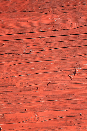 painted wood: Old wood  planks with a rust red brown peeling paint wash background Stock Photo