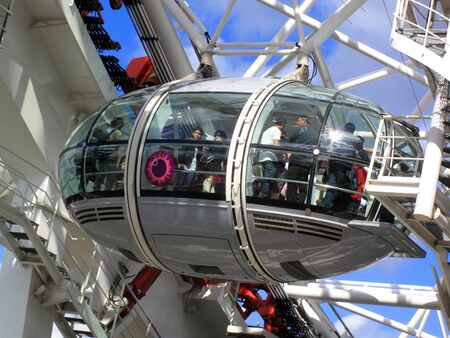 A Pod of The London Eye in London s Westminster full  of tourists enjoying the view