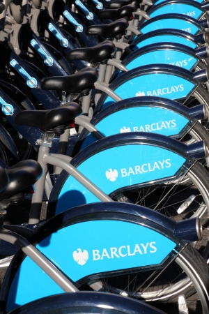 London Cycle Hire bikes at a docking station standing in a uniform row displaying Barclays Bank logo who sponsor the scheme