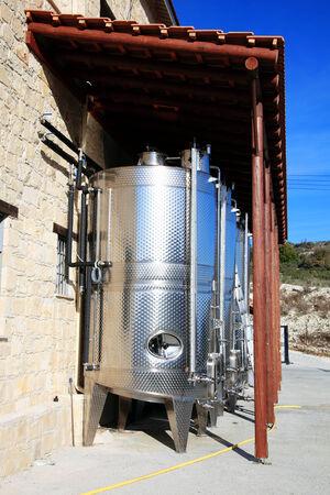 fermenting: Modern metal stainless steel wine vat casks fermenting grapes