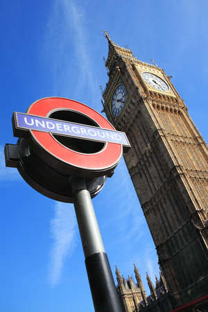 London, UK - Apr 9, 2011  London Underground sign at Westminster tube station with Big Ben in the background  photo