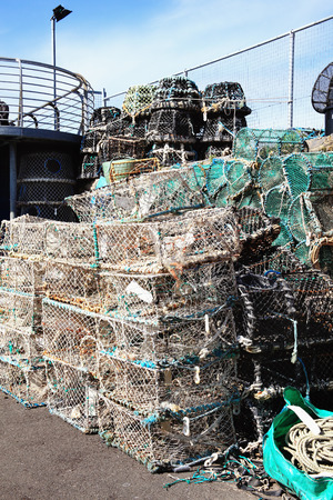 devon: Lobster traps and crab pots at a dock in Brixham,Devon, England, UK