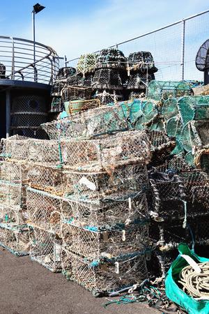 crab pots: Lobster traps and crab pots at a dock in Brixham,Devon, England, UK