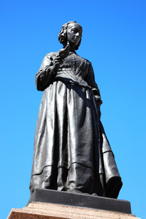 statistician: A bronze memorial statue of Florence Nightingale in Waterloo Place, Westminster, London, UK.
