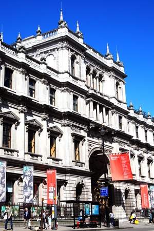 piccadilly: London, United Kingdom, April 13, 2014   The Royal Academy of Arts  is an arts institution based at Burlington House on Piccadilly  The banners are advertising summer exhibitions