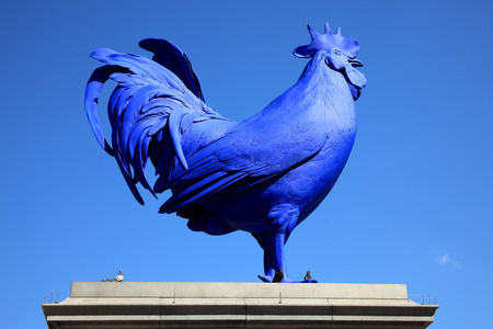 titled: London, United Kingdom, April 13, 2014  Recently unveiled by Mayor Boris Johnson the latest artwork to stand on Trafalgar Square s fourth plinth is a blue cockerel titled  Hahn Cock  by German artist Katharina Fritsch Editorial