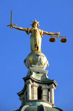 Scales of Justice of the Central Criminal Court fondly known as The Old Bailey in the city of London, England, UK, Europe