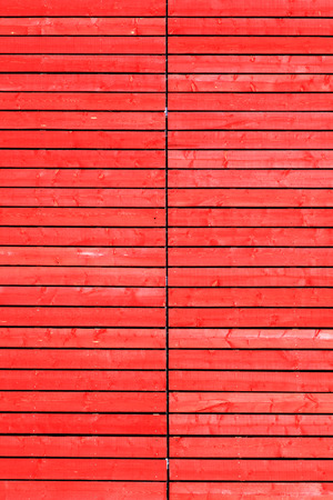 Wood planks panels fence wall background with red wash paint photo