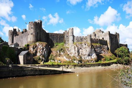 norman castle: Pembroke Castle, Pembroke, Pembrokeshire, Wales, UK on the River Cleddau is a ruin of a 11th century medieval moated castle