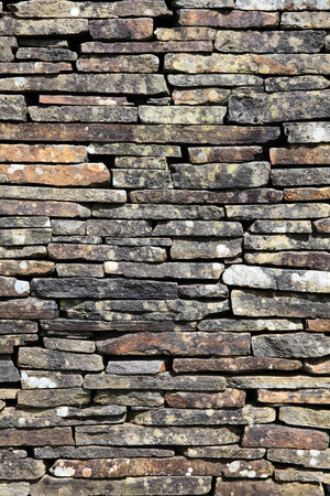 dry stone: Dry stone wall stacked high to form a boundary