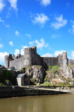 11th century: Pembroke Castle, Pembroke, Pembrokeshire, Wales, UK on the River Cleddau is a ruin of a 11th century medieval moated castle