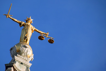 Scales of Justice   Lady of Justice  of the Central Criminal Court fondly known as The Old Bailey in the city of London, England, UK photo