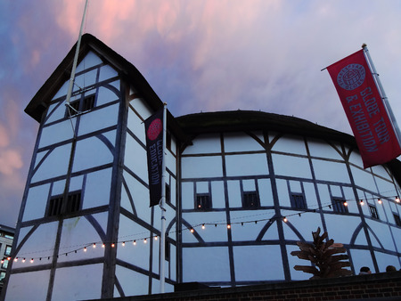 globe theatre:                          London, UK � January 27, 2013   The  Globe Theatre at dusk advertising tours and exhibitions with banners