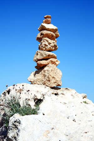Balanced rocks in a spiritual stacked zen-like\ arrangement
