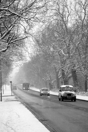 south london: London, UK ? Jan 20, 2013 : Black & White image of heavy snowfall on a South London during rush hour traffic